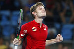 David Goffin of Belgium reacts after winning the match point against Rafael Nadal of Spain during their ATP Cup tennis match in Sydney, Friday, Jan. 10, 2020. (AP Photo/Steve Christo)