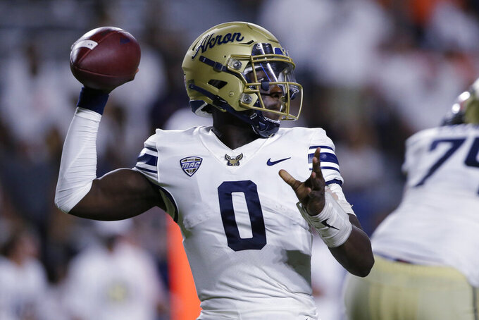 Akron quarterback DJ Irons throws a pass against Auburn during the second half of an NCAA college football game Saturday, Sept. 4, 2021, in Auburn, Ala. (AP Photo/Butch Dill)