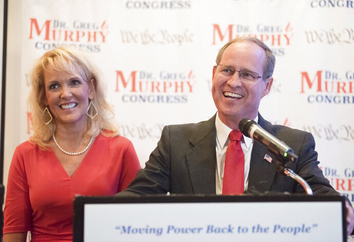 Dr. Greg Murphy speaks to supporters with his wife Wendy as he is announced the projected winner of North Carolina's Third Congressional District at the Hilton in Greenville, N.C. on Tuesday, Sept. 10, 2019. (Molly Mathis/The Daily Reflector via AP)
