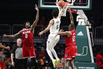 Miami guard Harlond Beverly (5) shoots as North Carolina State forward DJ Funderburk (0) and guard C.J. Bryce (13) defend during the first half of an NCAA college basketball game, Wednesday, Feb. 5, 2020, in Coral Gables, Fla. (AP Photo/Lynne Sladky)