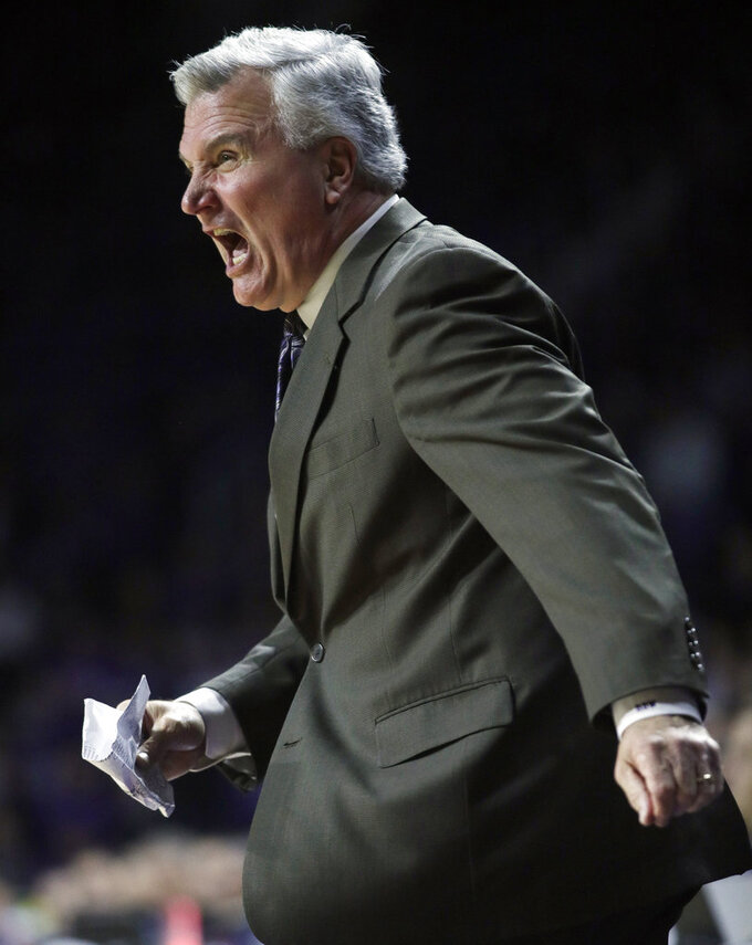 Kansas State coach Bruce Weber yells to his team during the first half of an NCAA college basketball game against West Virginia in Manhattan, Kan., Wednesday, Jan. 9, 2019. (AP Photo/Orlin Wagner)