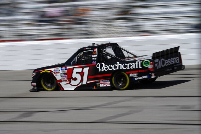 Kyle Busch (51) drives during a NASCAR Camping World Truck Series at Atlanta Motor Speedway on Saturday, March 20, 2021, in Hampton, Ga. (AP Photo/Brynn Anderson)