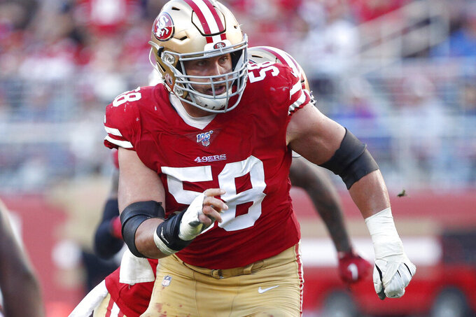 FILE - In this Nov. 17, 2019, file photo, San Francisco 49ers center Weston Richburg (58) works against the Arizona Cardinals during an NFL football game in Santa Clara, Calif. Richburg has retired after a knee injury derailed his career. The 29-year-old officially announced his retirement Wednesday, June 2, 2021. He missed the entire 2020 season recovering from knee surgery and remained on San Francisco's roster until now to delay some of the salary cap impact until 2021. (AP Photo/Josie Lepe, File)