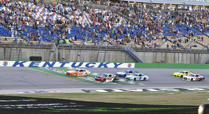 Austin Cindric (22) leads the field across the line at the start of the NASCAR Xfinity Series auto race at Kentucky Speedway in Sparta, Ky., Friday, July 12, 2019. (AP Photo/Timothy D. Easley)