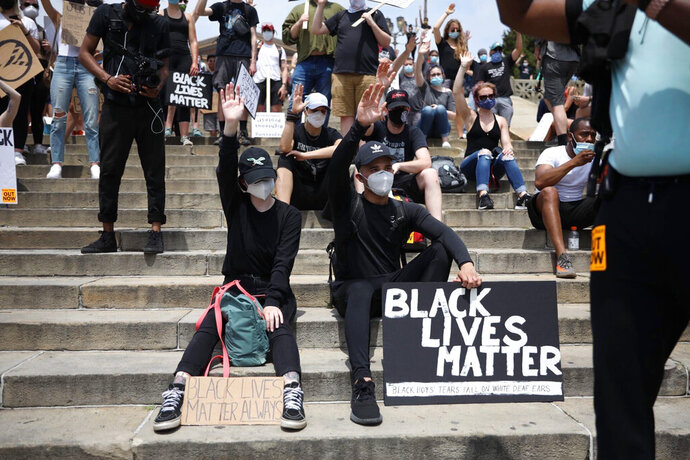 Christian Whittaker, Crisis Officer, speaks to a crowd of protestors with an open prayer at the Philadelphia Art Museum steps on Saturday, June 6, 2020, in Philadephia. People are protesting the death of George Floyd, who died after he was restrained in police custody on May 25 in Minneapolis. (Tyger Williams/The Philadelphia Inquirer via AP)