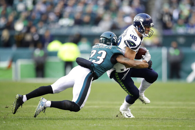 Seattle Seahawks' Jacob Hollister (48) is tackled by Philadelphia Eagles' Rodney McLeod (23) during the second half of an NFL football game, Sunday, Nov. 24, 2019, in Philadelphia. (AP Photo/Matt Rourke)