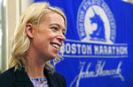 FILE -  In this photo April 14, 2016 file photo, Adrianne Haslet, a 2013 Boston Marathon bombing survivor, speaks at a news conference in Boston. Haslet, who had planned on running this year's race, says she can't physically do it after getting struck by a car last month. (AP Photo/Elise Amendola, File)