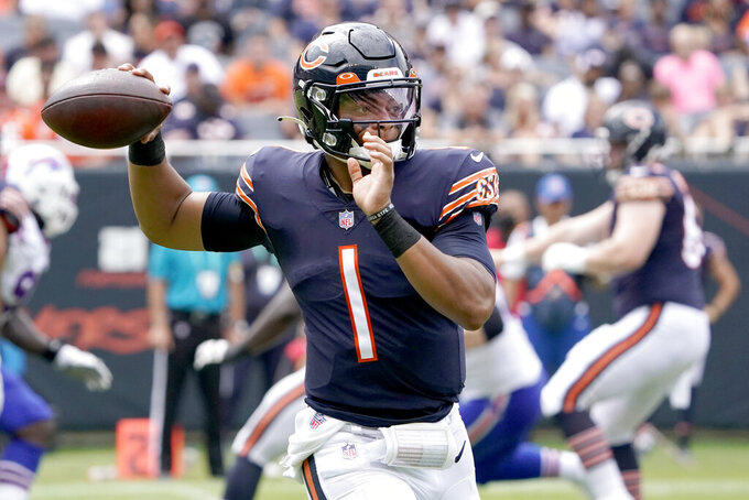 Chicago Bears quarterback Justin Fields passes during the second half of an NFL preseason football game against the Buffalo Bills Saturday, Aug. 21, 2021, in Chicago. (AP Photo/David Banks)