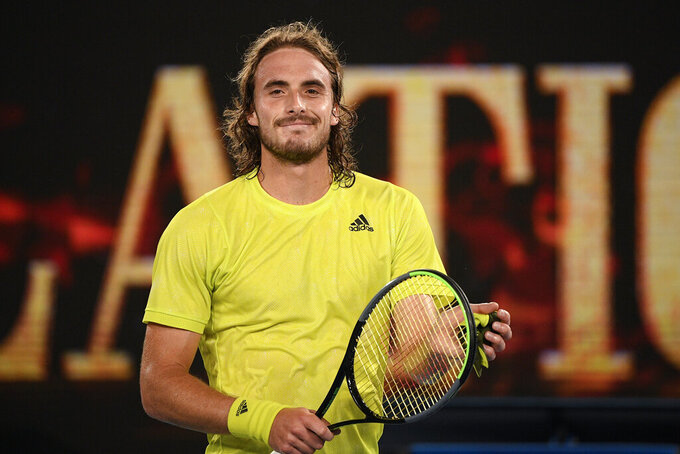 Greece's Stefanos Tsitsipas, smiles after defeating France's Gilles Simon after their first round match at the Australian Open tennis championship in Melbourne, Australia, Tuesday, Feb. 9, 2021. (AP Photo/Andy Brownbill)