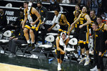 Iowa center Luka Garza, left, and Iowa guard Jordan Bohannon react on the bench in the second half of an NCAA college basketball game in East Lansing, Mich., Saturday, Feb. 13, 2021. Iowa won 88-58. (AP Photo/Paul Sancya)