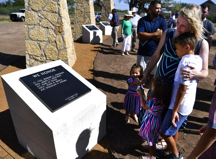 Jessica Vallejo remembers her grandfather John Brace as she holds her daughters Victoria and Abigail, and son Kristopher, Friday July 19, 2019 in Abilene, Texas. Vallejo came from Waco to the dedication of the Dyess Memorial Park extension with her husband Jose, her grandmother Martha, and other members of her family to honor her grandfather who died in a C-130 accident Oct. 12, 1966 in Guthrie with four other crewmen.   (Ronald W. Erdrich /The Abilene Reporter-News via AP)
