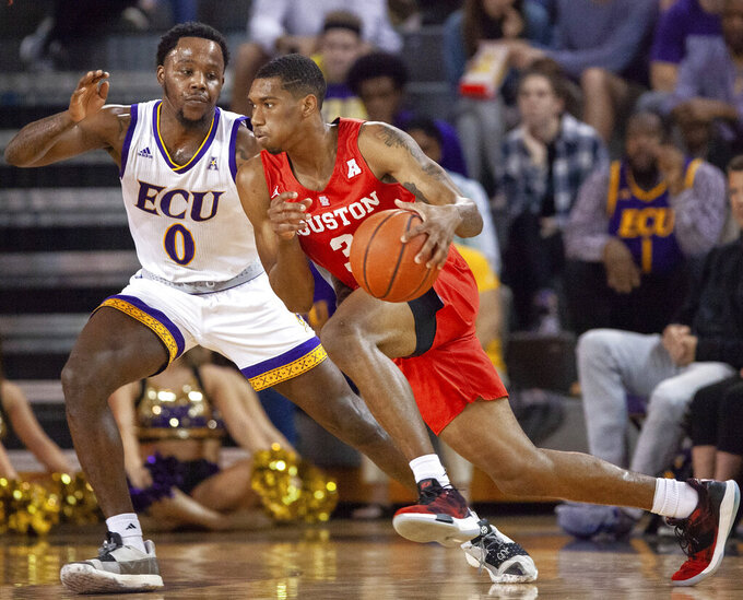 Houston's Armoni Brooks (3) handles the ball as East Carolina's Isaac Fleming (0) defends during the first half of an NCAA college basketball game in Greenville, N.C., Wednesday, Feb. 27, 2019. (AP Photo/Ben McKeown)