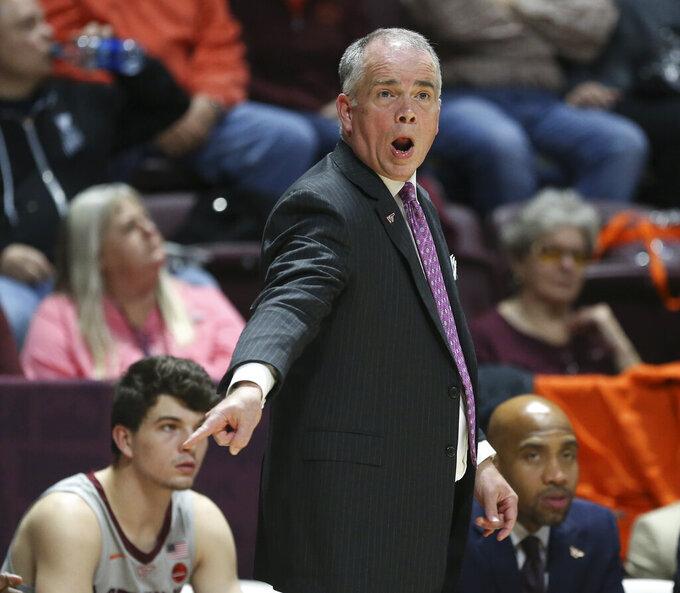 Virginia Tech head coach Mike Young in the first half of an NCAA college basketball game in Blacksburg Va. Wednesday, Nov. 20 2019. (Matt Gentry/The Roanoke Times via AP)