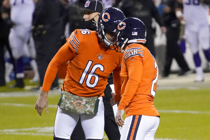 Chicago Bears place kicker Cairo Santos (2) is congratulated by teammate Pat O'Donnell (16) after kicking a 23-yard field goal during the first half of an NFL football game against the Minnesota Vikings Monday, Nov. 16, 2020, in Chicago. (AP Photo/Nam Y. Huh)