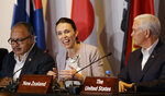 FILE - In this Nov. 18, 2018, file photo, New Zealand Prime Minister Jacinda Ardern, center, gestures beside U.S. Vice President Mike Pence, right, and Papua New Guinea Prime Minister Peter O'Neill during the Leaders Electrification Project meeting as part of the APEC 2018 at Port Moresby, Papua New Guinea. New Zealand on Tuesday, June 30, 2020, canceled its plans to host a major meeting of U.S. and Asian leaders next year because of the coronavirus, opting instead to lead a virtual summit. (AP Photo/Aaron Favila, File)