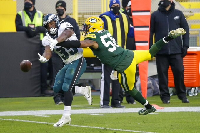 Green Bay Packers' De'Jon Harris breaks up a pass intended ofr Philadelphia Eagles' Boston Scott during the first half of an NFL football game Sunday, Dec. 6, 2020, in Green Bay, Wis. (AP Photo/Mike Roemer)