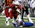 Iowa State running back David Montgomery (32) is tackled by Kansas defensive end Brian Lipscomb, back, during the first half of an NCAA college football game in Lawrence, Kan., Saturday, Nov. 3, 2018. (AP Photo/Orlin Wagner)