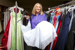 Jean Richardson speaks about the hundreds of prom dresses inside her north Cheyenne, Wyo., home, Tuesday, April 27, 2021. Richardson, the founder of Project Prom Cheyenne, has collected prom dresses for 15 years to give to students. Girls can make appointments to visit her home and find that perfect prom dress, which are mostly donated. (Michael Cummo/The Wyoming Tribune Eagle via AP)