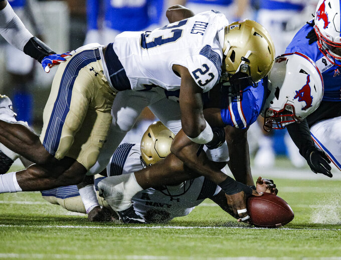 SMU defensive end Gary Wiley recovers a fumble by Navy quarterback Dalen Morris, bottom, as Navy running back Myles Fells (23) also reaches for the ball during the first half of an NCAA college football game Saturday, Oct. 31, 2020, in Dallas. (AP Photo/Brandon Wade)