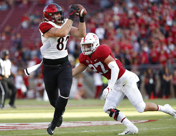 San Diego State tight end Kahale Warring (87) catches a pass in front of Stanford linebacker Sean Barton (27) during the first half of an NCAA college football game Friday, Aug. 31, 2018, in Stanford, Calif. (AP Photo/Tony Avelar)