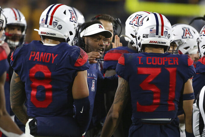 Arizona coach Kevin Sumlin encourages his team's defense as they play Arizona State during the first half of an NCAA college football game, Saturday, Nov. 30, 2019, in Tempe, Ariz. (AP Photo/Darryl Webb)