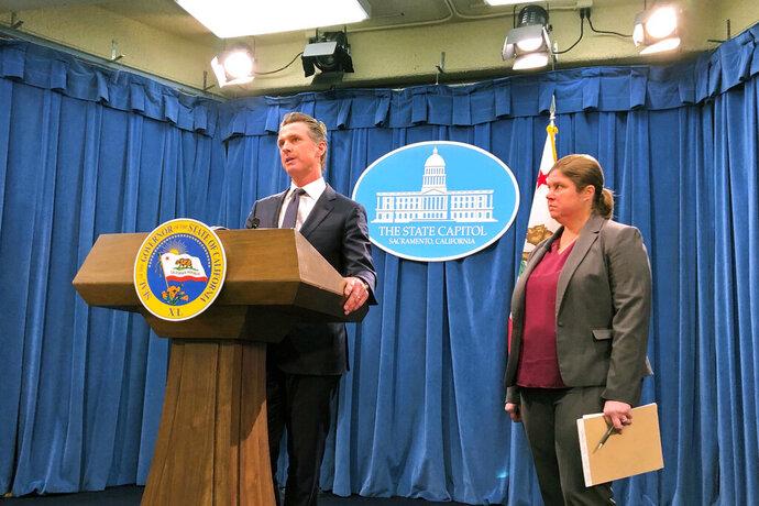 California Gov. Gavin Newsom announces the appointment of Ana Matosantos, right, as California's