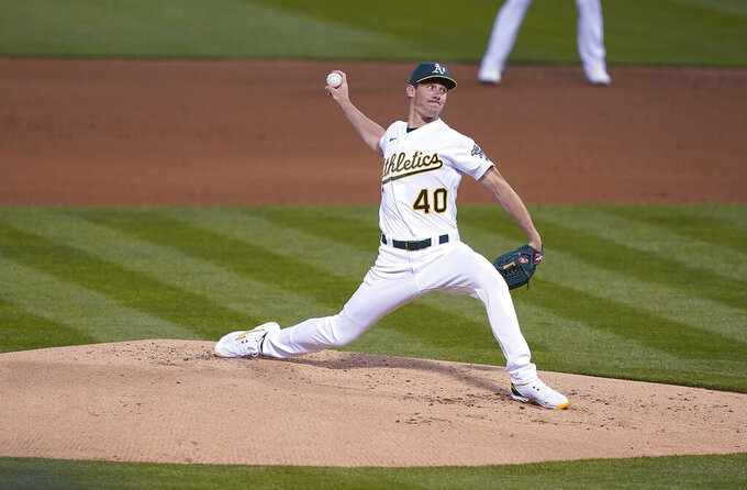 Oakland Athletics pitcher Chris Bassitt (40) throws against the Houston Astros in the second inning of an opening day baseball game Oakland, Calif., Thursday, April 1, 2021. (AP Photo/Tony Avelar)