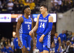 Kentucky's Immanuel Quickley, left, laughs with teammate Tyler Herro during the first half of an NCAA college basketball game against Missouri on Tuesday, Feb. 19, 2019, in Columbia, Mo. (AP Photo/L.G. Patterson)