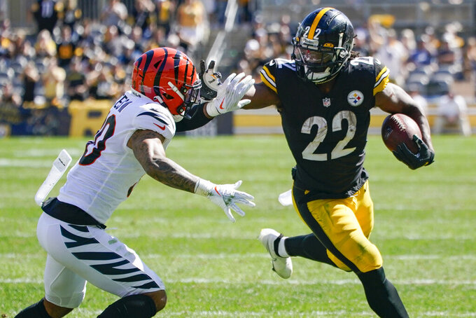 Pittsburgh Steelers running back Najee Harris (22) tries to break away from Cincinnati Bengals free safety Jessie Bates (30) during the first half an NFL football game, Sunday, Sept. 26, 2021, in Pittsburgh. (AP Photo/Gene J. Puskar)