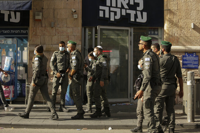 Israeli police inspect the scene of stabbing attack in Jerusalem's Central Bus Station Monday, Sept. 13, 2021. Israeli paramedics treated two people who were stabbed near Jerusalem's Central Bus Station by a suspected Palestinian assailant on Monday. (AP Photo/Maya Alleruzzo)