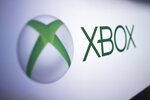 This Nov. 3, 2017, photo shows the logo Xbox at the Paris Games Week in Paris. Gaming is going green. Companies behind PlayStation, Xbox, Angry Birds, Minecraft, Twitch and other video games and platforms pledged Monday, Sept. 23, 2019, at the U.N. to level up efforts to fight climate change and get their throngs of users involved. (AP Photo/Kamil Zihnioglu)