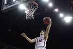 Oklahoma guard Austin Reaves puts up a shot during the first half of an NCAA college basketball game against Stanford Monday, Nov. 25, 2019, in Kansas City, Mo. (AP Photo/Charlie Riedel)