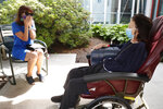 Marcie Abramson, left, becomes emotional as she speaks to her mother, Cynthia, outdoors at the Hebrew Rehabilitation Center, Wednesday June 10, 2020, in Boston, under the state's new nursing home visitation guidelines which requires social distancing. The two haven't been able to visit in person since March. (AP Photo/Elise Amendola)