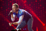 FILE - Chris Martin of Coldplay performs at Metlife Stadium in East Rutherford, N.J. on August 1, 2017. Coldplay's