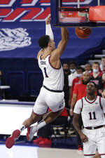 Gonzaga guard Jalen Suggs, left, dunks in front of teammate Joel Ayayi during the first half of an NCAA college basketball game against Loyola Marymount in Spokane, Wash., Saturday, Feb. 27, 2021. (AP Photo/Young Kwak)