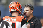 Cincinnati Bengals head coach Zac Taylor, right, talks with quarterback Andy Dalton, left, during the second half of an NFL football game against the Seattle Seahawks, Sunday, Sept. 8, 2019, in Seattle. (AP Photo/Stephen Brashear)