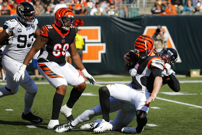 Jacksonville Jaguars defensive end Josh Allen, right, sacks Cincinnati Bengals quarterback Andy Dalton in the second half of an NFL football game, Sunday, Oct. 20, 2019, in Cincinnati. (AP Photo/Frank Victores)
