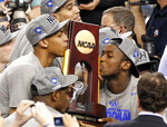 FILE - In this April 3, 2012, file photo, Kentucky forward Anthony Davis, left, and forward Michael Kidd-Gilchrist, right, kiss the trophy after the NCAA Final Four tournament college basketball championship game against Kansas in New Orleans. Davis had 16 rebounds, six blocks, five assists and three steals in the Wildcats' 67-59 victory over Kansas. His ability to help his team in so many different ways made him one of the best one-and-done players in college basketball history.  (AP Photo/Bill Haber, File)