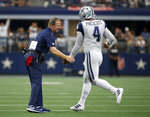 Dallas Cowboys head coach Jason Garrett, left, greets quarterback Dak Prescott (4) on the sideline after a Cowboys touchdown in the first half of a NFL football game against the Miami Dolphins in Arlington, Texas, Sunday, Sept. 22, 2019. (AP Photo/Ron Jenkins)