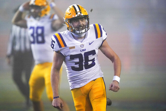 LSU's Cade York (36) celebrates after kicking a field goal against Florida in the final minute of an NCAA college football game Saturday, Dec. 12, 2020, in Gainesville, Fla. LSU won 37-34. (AP Photo/John Raoux)