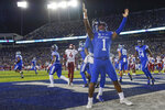 Kentucky quarterback Lynn Bowden Jr. (1) celebrates after scoring a touchdown during the first half of the team's NCAA college football game against Arkansas, Saturday, Oct. 12, 2019, in Lexington, Ky. (AP Photo/Bryan Woolston)