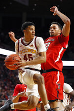 Iowa State guard Rasir Bolton (45) drives past Texas Tech forward TJ Holyfield, right, during the first half of an NCAA college basketball game Saturday, Feb. 22, 2020, in Ames, Iowa. (AP Photo/Charlie Neibergall)