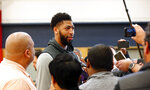 New Orleans Pelicans forward Anthony Davis talks to reporters after their NBA basketball practice in Metairie, La., Friday, Feb. 1, 2019. (AP Photo/Gerald Herbert)