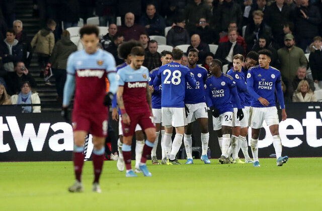 Leicester's Kelechi Iheanacho celebrates with teammates after scoring his side's opening goal during the English Premier League soccer match between West Ham Utd and Leicester City at the London Stadium in London, Saturday, Dec. 28, 2019. (AP Photo/Petros Karadjias)