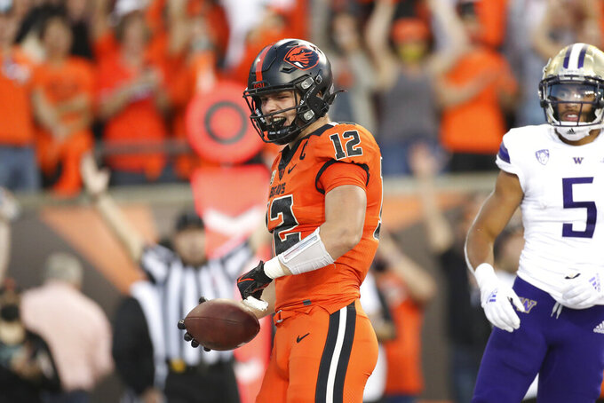 Oregon State inside linebacker Jack Colletto (12) celebrates after scoring a touchdown during the first half of an NCAA college football game against Washington on Saturday, Oct. 2, 2021, in Corvallis, Ore. (AP Photo/Amanda Loman)
