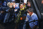 Takuma Sato, of Japan, reacts after kissing the bricks following his win of the Indianapolis 500 IndyCar auto race at the Indianapolis Motor Speedway, Sunday, Aug. 23, 2020, in Indianapolis. (AP Photo/AJ Mast)