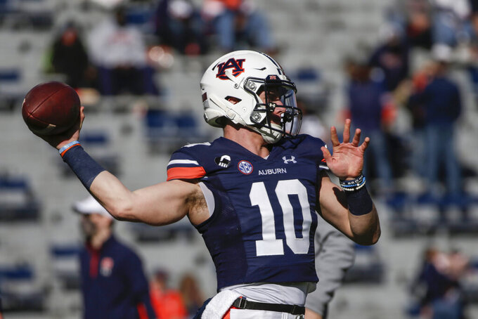 Auburn quarterback Bo Nix (10) warms up before the start of an NCAA college football game against Texas A&M on Saturday, Dec. 5, 2020, in Auburn, Ala. (AP Photo/Butch Dill)