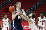 North Carolina State's Braxton Beverly (10) knocks the ball from Virginia's Sam Hauser (10) during the first half of an NCAA college basketball game Wednesday, Feb. 3, 2021, in Raleigh, N.C. (Ethan Hyman/The News & Observer via AP, Pool)