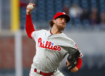 Philadelphia Phillies starting pitcher Aaron Nola (27) works in the first inning of a baseball game against the Atlanta Braves Monday, April 16, 2018, in Atlanta. (AP Photo/John Bazemore)