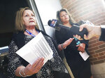 Madison School District interim superintendent Jane Belmore, left, and Madison School Board President Gloria Reyes address questions from the media following a rally in support of fired West High School security guard Marlon Anderson outside the district's offices in Madison, Wis. Friday, Oct. 18, 2019. (John Hart/Wisconsin State Journal via AP)